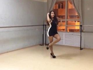 Girl in short dress dancing