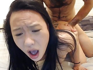 Tight Asian girl with tattoos fucks white bf