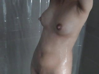 Post pregnancy engorged breast feeding wife taking a shower