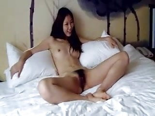 Cool hairy Chinese girl finally agrees to do nude photoshoot
