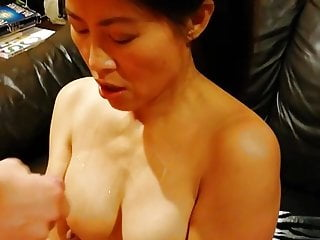 Big white dick cums on mature Chinese mom's small tits